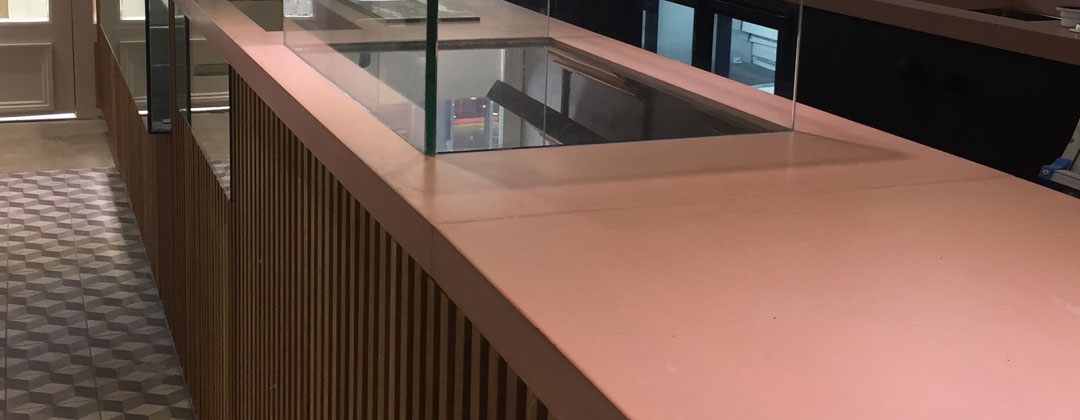 Light red, pink Concrete worktop - commercial project